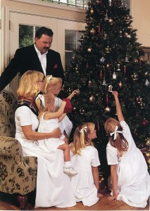 1996 - Decorating the Christmas tree with Nanette and their four daughters.
