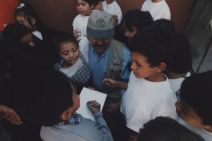 Thom drawing with Guatemalan children on one of his World Vision trips. Circa 1999