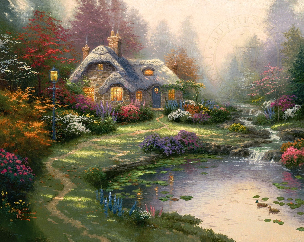 A cottage by a lake. The setting is surrounded by flowers.