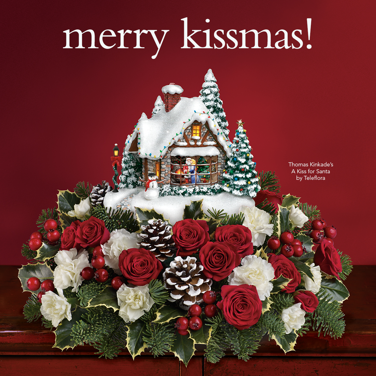 "Thomas kinkade s ""a kiss for santa teleflora centerpiece"